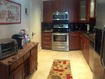 Fully equipped kitchen with stainless appliances for all your cooking needs. Kurieg coffee in unit