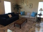 Spacious living area with sleep sofa.