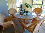 outdoor dining in screened porch
