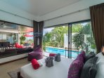 Pool and ocean views from 2nd guest bedroom with double bed, TV, Apple Tv box