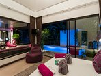 Night time pool and terrace  view from 2nd guest bedroom with double bed, TV, Apple Tv box