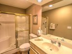 Prepare for a good night's rest with your nightly routine in this full bathroom.