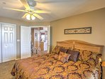This master bedroom features a king-sized bed offering enough space to find your most comfortable spot!