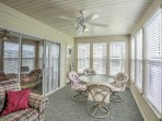 You'll love eating on the sun porch with natural lighting and golf course views below!