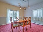 The formal dining room is simplistically decorated and features double doors that open to the spacious backyard!