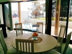 Dining area with Balcony behind
