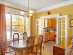 The formal dining room opens up to the kitchen for easy flow.