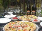 Enjoy wood-fired pizza and local wine with your river view