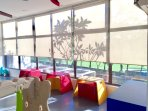 Vibrant seats and windows with roller blinds for the kids' comfort