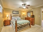 The master bedroom features a queen-sized bed, flat screen TV, and ensuite bath.