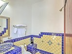 The bathroom reflects the intricate tile details of the Colonial Mexican decor.