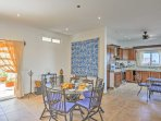 Enjoy delicious home-cooked meals at the dining table set for 6.