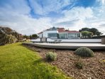 Stunning modern home with pool & sea views from both the house and gardens