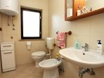 Bathroom with bidet and walk-in shower