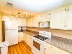 Freshly redecorated kitchen, hard finish countertops.