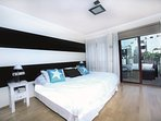 Master Bedroom with Kind Size Bed, en-suite bathroom, walk able closet and private terrace