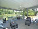 Large screened porch overlooking the water