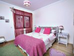 The second bedroom with double bed, walk able closet and en suite bathroom