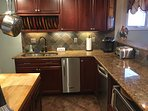 Kitchen - granite countertops, under counter ice maker, dishwasher, microwave.
