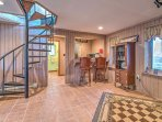Down the spiral staircase is the wet bar and second lounging area, complete with cozy furnishings, a propane stove...