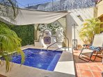 This luxurious home features a custom built pool and spa with wet bar for the perfect place for a respite.