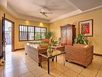 Unwind in the living room with custom built furniture and flat screen TV.