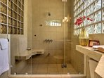 Step into the huge walk-in shower with additional faucet for rinsing off sandy feet.