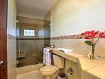 Wash off sandy feet in this large walk-in shower.
