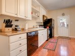 Plenty of space to cook together. Leads to nice rear patio with picnic table and gas grill