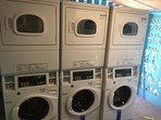 Modern self serve laundry with 5 washers and 5 gas dryers.