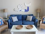 Comfortable Couch and Loveseat in Living Area; Mermaid by Local Artist, Lucy Designs
