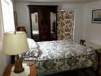 Guest suite full bed,  amoir.  Privacy from sleeping porch. En suite bath.