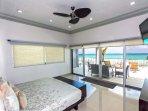 Master Suite with King Bed, TV, ocean view and en suite bathroom