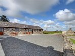 There is plenty of gravelled parking for this pair of cottages