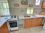 The fitted pine kitchen is equipped with a washing machine
