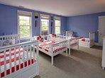 Four twin beds with a second nautical theme round out the second floor.