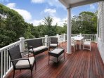 Over 1000 feet of wraparound mahogany deck overlooks the lilly pond