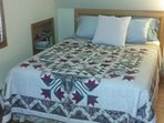 Master Bed with Amish Quilt