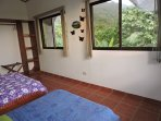 Upstairs Room: Two beds (Full and Twin) mountain and ocean views