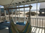 Screened in porch with ocean view.