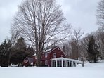 Winter view of the home and the huge sugar maple in the front yard.