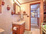 This full bathroom is located directly off the dining area.