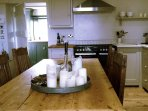 Farmhouse dining table in beautiful communal kitchen.