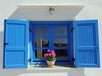 Captain's Home-ART the traditional blue window of Cyclades