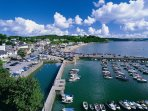 Saundersfoot harbour, shops and sandy beaches.