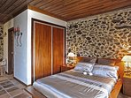 Romantic bedrooms in Casa Antica with their own bathrooms with shower, sink and toilet.