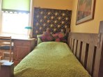 Bedroom furniture consists of a comfortable solid wooden bed and matching qualiy furniture