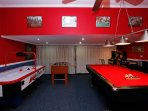 TV, foosball, air hockey, darts arcade machine and pool table
