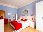 Large blue bedroom.