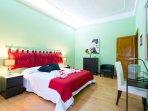 Large green bedroom.
